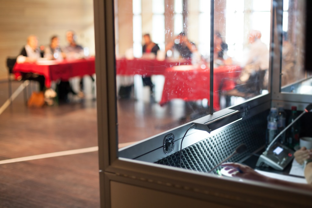 Simultaneous interpretation in a booth during a conference